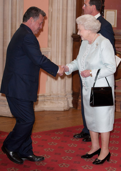King Abdullah II is greeted by Queen Elizabeth II at a lunch For Sovereign Monarchs in honour of Queen Elizabeth II's Diamond Jubilee, at Windsor Castle, on May 18, 2012 in Windsor, England.