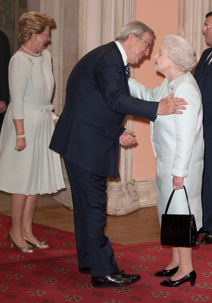Queen Anne Marie Of Greece and King Constantine of Greece are greeted by Queen Elizabeth II as they arrive at a lunch for Sovereign Monarch's held in honour of Queen Elizabeth II's Diamond Jubilee, at Windsor Castle, on May 18, 2012 in Windsor, England.