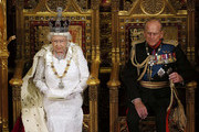 Queen Elizabeth II sits with Prince Philip, Duke of Edinburgh as she delivers her speech during the State Opening of Parliament in the House of Lords at the Palace of Westminster on June 4, 2014 in London, England. Queen Elizabeth II is to unveil the coalition government's legislative programme in a speech delivered to Members of Parliament and Peers in The House of Lords. Proposed legislation is expected to be introduced on a 5p charge for plastic bags in England, funding of workplace pensions, new state-funded childcare subsidy and reforms to speed up infrastructure projects.
