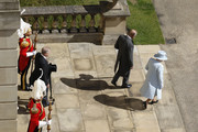 Queen Elizabeth II and the Prince Philip, Duke of Edinburgh arrive for her garden party held at Buckingham Palace on June 10, 2014 in London, England.