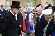 Prince Philip, Duke of Edinburgh meets guests during a garden party at Buckingham Palace on May 19, 2016 in London, England.