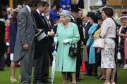 Queen Elizabeth II meets guests during a garden party at Buckingham Palace on May 19, 2016 in London, England.