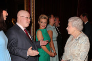 Queen Elizabeth II meets actors Sheriden Smith (C) and Matt Lucas (2nd L) during her reception to celebrate the patronages & affiliations of the Earl and Countess of Wessex at Buckingham Palace on February 10, 2015 in London, England