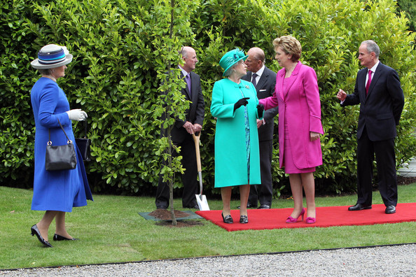 Queen Elizabeth II Queen Elizabeth II speaks with President Mary Mc Aleese after planting a tree at ceremony in Aras An Uachtarain while on the first day of her State Visit on May 17, 2011 in Dublin,Ireland. The Queen's visit, accompanied by The Duke of Edinburgh, is the first by a monarch since 1911. An unprecedented security operation is taking place with much of the centre of Dublin turning into a car free zone. Republican dissident groups have made it clear they are intent on disrupting proceedings.