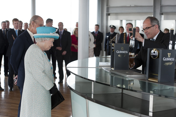 Queen Elizabeth II Queen Elizabeth II (C) and Prince Philip, Duke of Edinburgh (L) watch a pint of Guinness being poured as they visit the Guinness Storehouse on May 18, 2011 in Dublin, Ireland. The Duke and Queen's visit to Ireland is the first by a British monarch since 1911. An unprecedented security operation is taking place with much of the centre of Dublin turning into a car-free zone. Republican dissident groups have made it clear they are intent on disrupting proceedings.