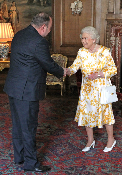 Queen Elizabeth II Meets Scottish First Minister [fashion,event,gesture,elizabeth ii,alex salmond,first minister,scottish,scotland,edinburgh,palace of holyroodhouse,l,landslide victory,elections]