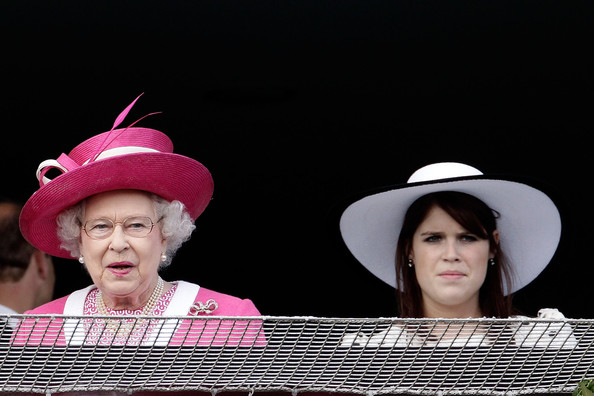 Queen Elizabeth II Queen Elizabeth II and Princess Eugenie react as the Queen's horse Carlton House comes in third in the Epsom Derby at Epsom Downs racecourse on June 4, 2011 in Epsom, England. Carlton Hall had been the Bookmakers favourite to win the Derby, but came in third place, with Pour Moi winning.