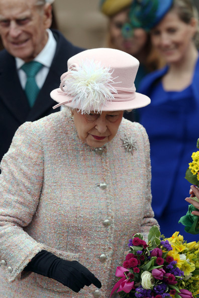 The Royal Family Attend The Easter Matins Service At Windsor Castle [the royal family,yellow,ceremony,event,flower,tradition,headgear,headpiece,wedding,plant,marriage,elizabeth ii,children,service,flowers,windsor castle,grounds,england,easter matins service,easter day]