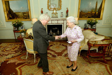 Queen Elizabeth II Investitures Held at Buckingham Palace