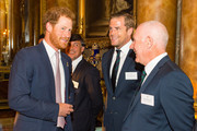 Prince Harry (left) speaks to Irish Rugby Union player Jamie Heaslip and Ireland head coach Mick Kearney (right) at a Rugby World Cup reception at Buckingham Palace on October 12, 2015 in London, United Kingdom.