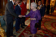 Queen Elizabeth II shakes hands with England Rugby Union captain Chris Robshaw (left) during a reception to mark the Rugby World Cup 2015 at Buckingham Palace on October 12, 2015 in London, United Kingdom.