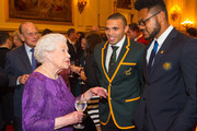 Queen Elizabeth II and Prince Philip, Duke of Edinburgh (left) with South Africa's Bryan Habana (second right) and Australia's Henry Speight (right) at a Rugby World Cup reception at Buckingham Palace on October 12, 2015 in London, United Kingdom.