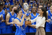 Queen Letizia of Spain (R) hands Silvia Dominguez (L) of Perfumerias Avenida the Queen Cup trophy at the end of the Spanish 'Queen Cup' basketball final between Perfumerias Avenida and Spar CityLift Girona at Sanchez Paraiso stadium on March 08, 2020 in Salamanca, Spain.