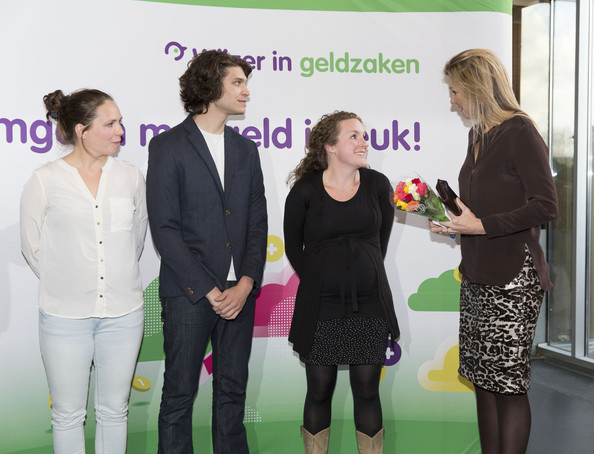 Queen Maxima of The Netherlands talks with young actors during an evening with parents discussing financial education at elementary school The Archipel on April 14, 2014 in Almere, Netherlands.