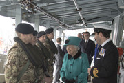 Queen Elizabeth II meets with personnel on the upper deck as Commander Andrew Canale (R), MVO, RN looks on during her visit HMS Sutherland in the West India Dock as the ship celebrates its 20th anniversary of her Commissioning on October 23, 2017 in London, England.