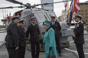 Queen Elizabeth II is greeted by Commander Andrew Canale (R), MVO, RN as she visits HMS Sutherland in the West India Dock as the ship celebrates its 20th anniversary of her Commissioning on October 23, 2017 in London, England.