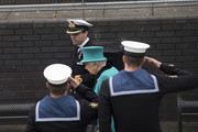 Queen Elizabeth II is escorted by Commander Andrew Canale (L), MVO, RN as she visits HMS Sutherland in the West India Dock as the ship celebrates its 20th anniversary of her Commissioning on October 23, 2017 in London, England.