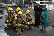 Queen Elizabeth II meets personnel as she visits HMS Sutherland in the West India Dock as the ship celebrates its 20th anniversary of her Commissioning on October 23, 2017 in London, England.