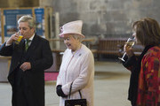 Queen Elizabeth visits the Palace of Westminster to view the Diamond Jubilee Window which has been installed in the Great Window of Westminster Hall, accompanied by House of Lords Speaker Baroness D'Souza (R) and House of Commons Speaker John Bercow (L) on December 6, 2013 in London, England.