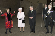 Queen Elizabeth visits the Palace of Westminster to view the Diamond Jubilee Window which has been installed in the Great Window of Westminster Hall, accompanied by House of Lords Speaker Baroness D'Souza (L) and House of Commons Speaker John Bercow (2nd R) and Black Rod (R) on December 6, 2013 in London, England.