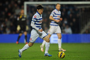 Ji-Sung Park of Queens Park Rangers runs with the ball during the Barclays Premier League match between Queens Park Rangers and Aston Villa at Loftus Road on December 1, 2012 in London, England.