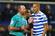 Bobby Zamora (25) protests to referee Mike Dean as Charlie Austin's goal is disallowed during the Barclays Premier League match between Queens Park Rangers and Manchester City at Loftus Road on November 8, 2014 in London, England.