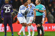 Leroy Fer (2L), Bobby Zamora (C) and Karl Henry of QPR (R) protest to referee Mike Dean as Charlie Austin's goal is disallowed during the Barclays Premier League match between Queens Park Rangers and Manchester City at Loftus Road on November 8, 2014 in London, England.