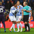 Mike Dean Photos - Leroy Fer (2L), Bobby Zamora (C) and Karl Henry of QPR (R) protest to referee Mike Dean as Charlie Austin's goal is disallowed during the Barclays Premier League match between Queens Park Rangers and Manchester City at Loftus Road on November 8, 2014 in London, England. - Queens Park Rangers v Manchester City - Premier League