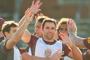 Billy Slater, Cameron Smith and Sam Thaiday celebrate during a Queensland Maroons State of Origin team training session at Punt Road Oval on June 11, 2015 in Melbourne, Australia.