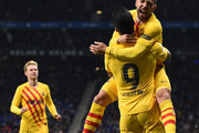 Luis Suarez of FC Barcelona celebrates with teammate Jordi Alba after scoring his team's first goal during the La Liga match between RCD Espanyol and FC Barcelona at RCDE Stadium on January 04, 2020 in Barcelona, Spain.
