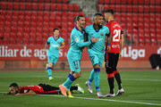 Arturo Vidal of FC Barcelona celebrates after scoring his team's first goal with Antoine Griezmann of FC Barcelona during the La Liga match between RCD Mallorca and FC Barcelona at Estadio de Son Moix on June 13, 2020 in Mallorca, Spain.