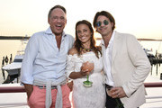 Andrew Saffir, Shoshanna Gruss and Rodger Berman attend the Rachel Zoe Collection Summer Dinner at Moby's East Hampton with FIJI Water, Tanqueray, and AUrate on August 01, 2019 in East Hampton, New York.
