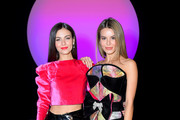 Victoria Justice (L) and Madison Reed attend the Raisavanessa front row during New York Fashion Week: The Shows at Gallery I at Spring Studios on February 12, 2020 in New York City.