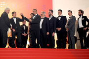"""Cast and Major of Cannes David Lisnard  *the movie attend the screening of """"Rambo - First Blood"""" during the 72nd annual Cannes Film Festival on May 24, 2019 in Cannes, France."""