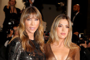"""Jennifer Flavin and Sistine Rose Stallone attend the screening of """"Rambo - First Blood"""" during the 72nd annual Cannes Film Festival on May 24, 2019 in Cannes, France."""