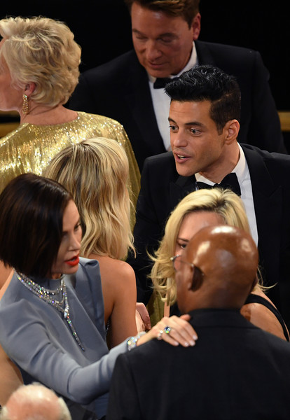 91st Annual Academy Awards - Show [event,hairstyle,interaction,conversation,formal wear,rami malek,charlize theron,academy awards,l-r,california,hollywood,dolby theatre,show,annual academy awards]