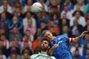 David Wier (R) of Rangers jumps for a ball with Georgios Samaras of Celtic during the Clydesdale Bank Premier League match between Rangers and Celtic at Ibrox Stadium salutes his supporters  on April 24, 2011 in Glasgow, Scotland.