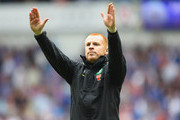 Neil Lennon coach of Celtic salutes his supporters at the end of the Clydesdale Bank Premier League match between Rangers and Celtic at Ibrox Stadium on April 24, 2011 in Glasgow, Scotland.