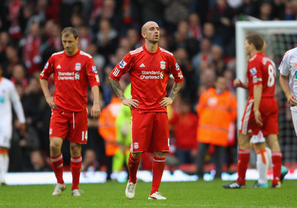Raul Meireles Raul Meireles of Liverpool looks dejected after defeat to