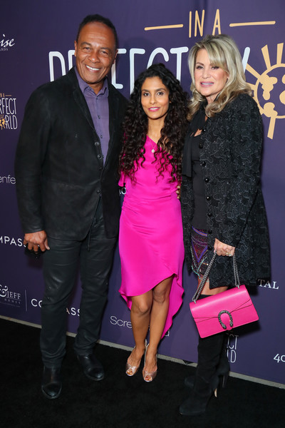 Manuela Testolini And Eric Bent Present An Evening Of Music, Art And Philanthropy Benefiting In A Perfect World Honoring Prince - Arrivals [fashion,event,pink,suit,premiere,dress,award,fashion design,award ceremony,performance,arrivals,manuela testolini,prince,elaine parker,ray parker jr.,the jeremy hotel,west hollywood,california,eric bent present an evening of music,art and philanthropy benefiting in a perfect world]