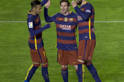 Lionel Messi (2ndL) of FC Barcelona celebrates scoring their third goal with teammates Neymar JR. (L) and Gerard Pique (R) during the La Liga match between Rayo Vallecano de Madrid and FC Barcelona at Estadio de Vallecas on March 3, 2016 in Madrid, Spain.