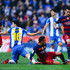 Sergio Busquets (R) and Neymar (C) of FC Barcelona competes for the ball with Javi Lopez of RCD Espanyol during the La Liga match between RCD Espanyol and FC Barcelona at Cornella-El Prat Stadium on January 2, 2016 in Barcelona, Spain.