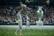 Gareth Bale of Real Madrid CF holds his daughter during the Real Madrid celebration the day after winning the UEFA Champions League Final at Santiago Bernabeu stadium on May 25, 2014 in Madrid, Spain.