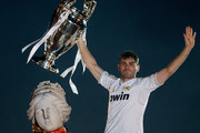 Captain goalkeeper Iker Casillas of Real Madrid CF holds the UEFA Champions League cup celebrating their victory on the UEFA Champions League Final match against Club Atletico de Madrid at Cibeles font  on the early morning of May, 25, 2014 in Madrid, Spain. Real Madrid CF achieves their 10th European Cup at Lisbon 12 years later.