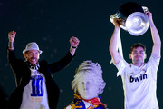 Captain goalkeeper Iker Casillas of Real Madrid CF holds the UEFA Champions League cup celebrating with his teammate Sergio Ramos their victory on the UEFA Champions League Final match against Club Atletico de Madrid at Cibeles font  on the early morning of May, 24, 2014 in Madrid, Spain. Real Madrid CF achieves their 10th European Cup at Lisbon 12 years later.