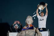 Captain goalkeeper Iker Casillas (R) of Real Madrid CF holds the UEFA Champions League cup as his teammate Sergio Ramos (L) shows his 10 fingers as an allusion to the European cups their Club has during the celebration of their victory on the UEFA Champions League Final match against Club Atletico de Madrid at Cibeles font on the early morning of May, 25, 2014 in Madrid, Spain. Real Madrid CF achieves their 10th European Cup at Lisbon 12 years later.