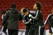 James Rodriguez of Real Madrid CF jokes with Pepe and Marcelo during a training session at Anfield on October 21, 2014 in Liverpool, United Kingdom.