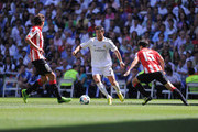 Cristiano Ronaldo (C) of Real Madrid takes on Ander Iturraspe (L) and Andoni Iraola of Athletic Club Bilbao during the La Liga match between Real Madrid CF and Athletic Club Bilbao at estadio Santiago Bernabeu on September 1, 2013 in Madrid, Spain.