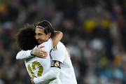 Sergio Ramos of Real Madrid celebrates with Marcelo of Real Madrid following their sides victory in the Liga match between Real Madrid CF and FC Barcelona at Estadio Santiago Bernabeu on March 01, 2020 in Madrid, Spain.
