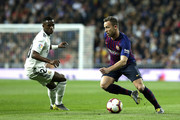 Arthur of Barcelona takes on Vinicius Junior of Real Madrid  during the La Liga match between Real Madrid CF and FC Barcelona at Estadio Santiago Bernabeu on March 02, 2019 in Madrid, Spain.